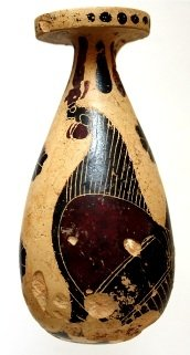 Alabastron (perfume flask) with a large rooster facing left and surrounded by blob rosettes, imported from Corinth, from the Scavi Kleibrink 1991-2003, now in the National Archaeological Museum at Sibari, dated around 600BC.