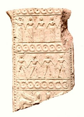 Fragment of the sacred apron of a terracotta pinax (plaque) representing the goddess Athena, found on the Timpone della Motta, 7th c. BC, height 13.3 cm, National Archaeological Museum, Sibari.
