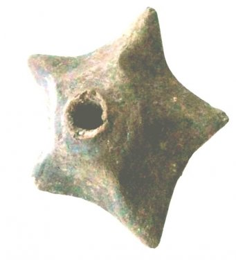 Star-shaped spindle whorl, found during the Scavi Kleibrink 1991-2004 on the Timpone della Motta, 8th century BC, now in the National Archaeological Museum, Sibari.