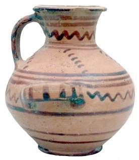 Hydriska (miniature water jar) decorated with wavy and plain bands,  found on the Timpone della Motta, Late Geometric, 2nd half 7th c. BC, National Archaeological Museum, Sibari.