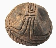 Impasto loom weight of spherical type with a horizontal hole through the top and decorated with an incised meander pattern. Found during the Scavi Kleibrink on the Timpone della Motta, AC18.15.w215, first half 8th century BC. National Archaeological Museum of the Sibaritide, Sibari.