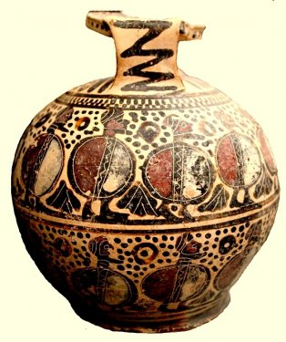 Large aryballos (flask for perfumed oil) decorated with two friezes of warriors, height 16 cm. Imported from Corinth and an example of the Middle Corinthian style, first half of the 6th century BC. From the former Bern-Getty collection of objects looted from the Temple plateau of the Timpone della Motta and now in the National Archaeological Museum at Sibari.